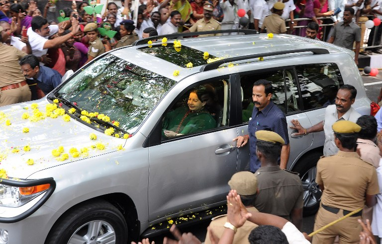Jayalalithaa Jayaram, chief of the All India Anna Dravida Munnetra Kazhagam (AIADMK) party, is seen in her car during her first public appearance in months on May 22, 2015, following her clearance in a disproportionate assets case. The head of India's largest Tamil party was cleared of corruption May 11, paving the way for the return of one of the country's most powerful politicians. AFP PHOTO / AFP PHOTO / STR