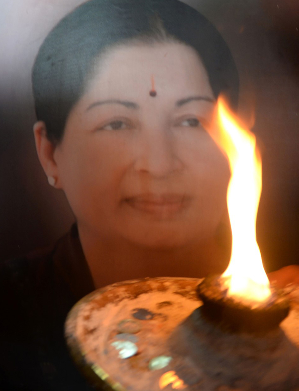 supporters-hold-a-photo-of-tamil-nadus-late-chief-minister-jayalalithaa-jayaram-as-they-offer-prayers-for-her-well-being-at-a-temple-in-mumbai-on-december-5-2015-afp