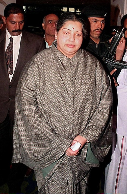 """(FILES) Jayalalitha Jayaram, former chief minister of the southern Indian state of Tamil Nadu, pictured 19 November, 1996. The infamous Jayalalitha Jayaram, whose house disgorged 10,500 sarees, 400 pairs of of shoes as well as around 30 kilograms (66 pounds) of gold and jewellery when it was raided by police, """"represented an extraordinary example"""" of India's political corruption, an Indian sociologist said. What made those discoveries more delicious was that the former actress-turned-politcian had proudly announced to her adoring followers that she would only pay herself one rupee a month for running Tamil Nadu. AFP PHOTO/FILES/RAVEENDRAN / AFP PHOTO / RAVI RAVEENDRAN"""